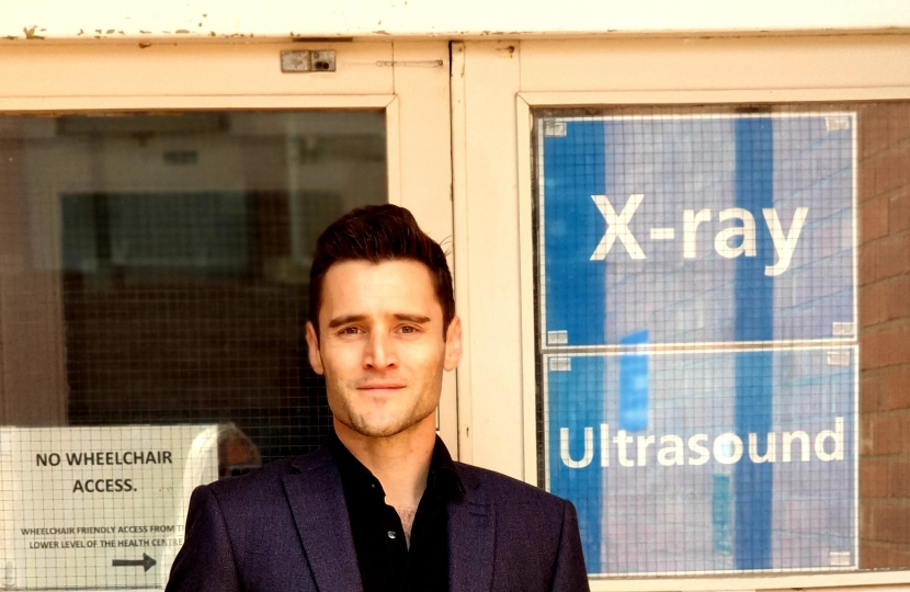 Dr Luke Evans Outside Mount Road X-Ray Department in Hinckley