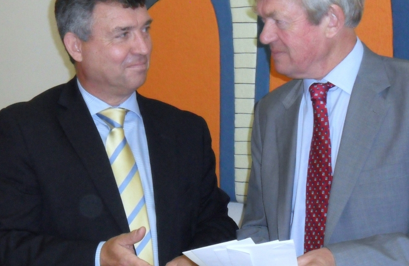 Sir Clive Loader and David Tredinnick MP discussing local policing issues.